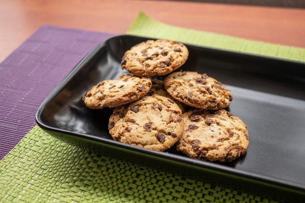 Five cookies on a aluminium sheet tray