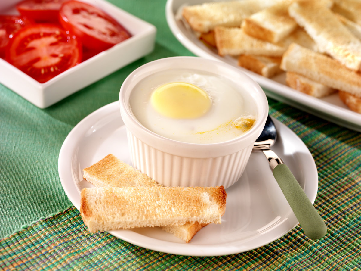 A coddled egg with toast