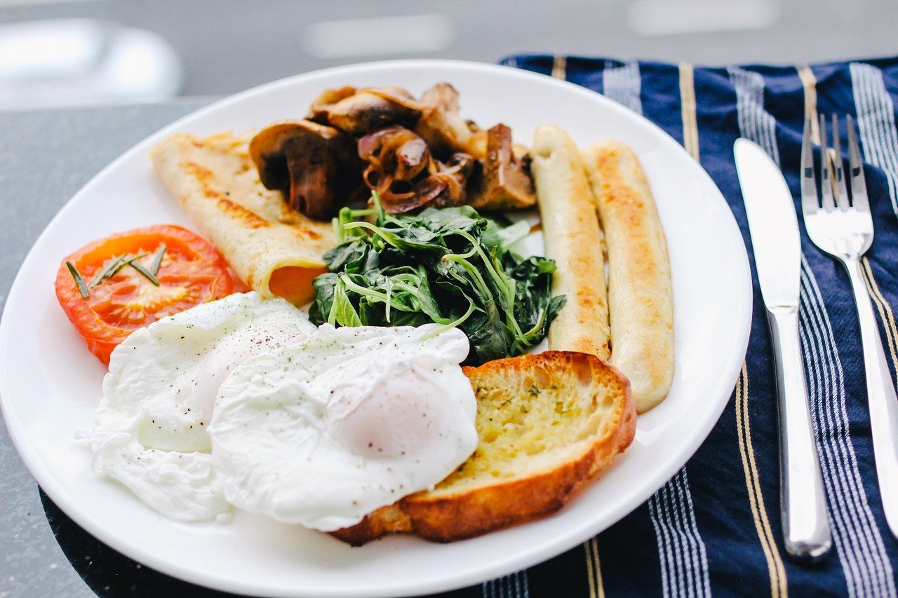 Poached eggs with a fried breakfast