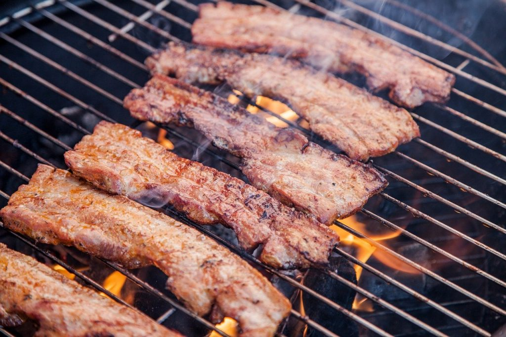 Meat cooking on a barbecue